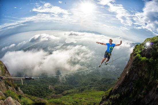 A Highliner Traverses Two Cliffs Above Rio De Janeiro-Keith Ladzinski-Photographic Print