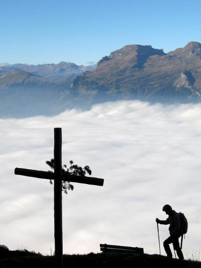 A Hiker Above Triesen in Liechtenstein Enjoys the View over the Sea of Fog-Arno Balzarini-Photographic Print