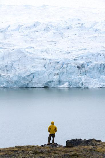 A Hiker Dwarfed by the Fracture Zone of a Glacier on the Greenland Ice Sheet-Jason Edwards-Photographic Print