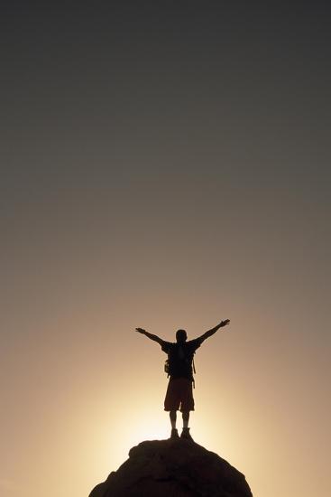 A Hiker Raises His Arms to Celebrate His Success-Macduff Everton-Photographic Print
