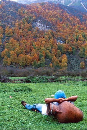 A Hiker Relaxes with His Head on an Urn, and a View of Autumn Colors in the Dohezar Forest-Babak Tafreshi-Photographic Print