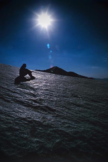 A Hiker Sits on a Glacier Near the Peak of Mount Sialan in the Alborz Mountains of Iran-Babak Tafreshi-Photographic Print