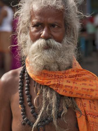 https://imgc.artprintimages.com/img/print/a-hindu-holy-man-or-sadhu-near-manikula-on-the-outskirts-of-kolkata_u-l-pfxqgx0.jpg?p=0