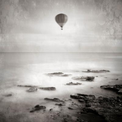 A Hot Air Balloon Floating Above the Sea-Trigger Image-Photographic Print