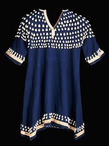 A Hunkpapa Sioux Girl's Dress of Blue Wool Cloth Trimed with Cowrie