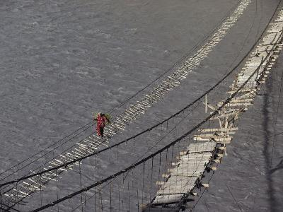 A Hunzukut Woman Crosses a Footbridge over the Hunza River, Constructed of Tied Juniper Branches-Jonathan Blair-Photographic Print