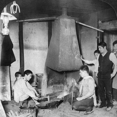 A Japanese Blacksmith at His Forge, Yokohama, Japan, 1904-Underwood & Underwood-Photographic Print