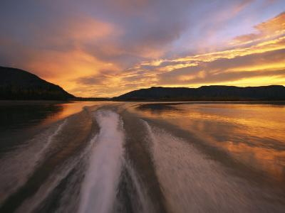 A Jet Boat Leaves a Wake in the Mackenzie River at Sunset-Raymond Gehman-Photographic Print