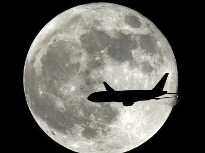 A Jet Plane Passes in Front of the Full Moon Above Surfside, Fla.--Photographic Print