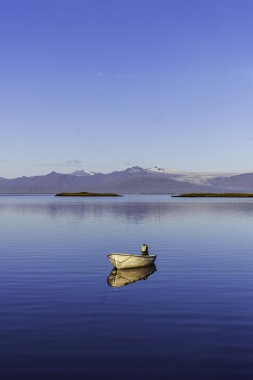 A Johnboat with An Outboard Motor and Its Reflection in Calm Blue Water-Jonathan Irish-Photographic Print