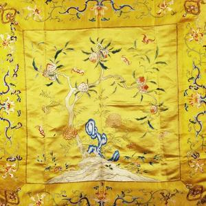 A Kang Cover of Yellow Satin, Finely Embroidered with a Peach Tree Growing from a Rocky Hill with…