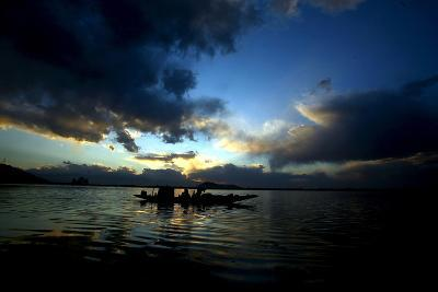 A Kashmiri Fisherman Rows His Boat on Dal Lake in Srinagar, the Summer Capital of Indian Kashmir-Farooq Khan-Photographic Print