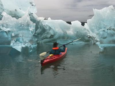 A Kayak Paddler Passes Sculpted Icebergs in Tracy Arm Fjord-Ralph Lee Hopkins-Photographic Print