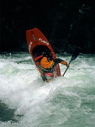A Kayaker Paddles in Waves on the Kananskis River, Near Calgary-Gordon Wiltsie-Photographic Print