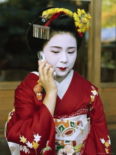 A Kimono-Clad Geisha Talks on a Cell Phone--Photographic Print