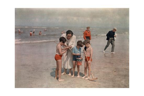 A Lady Examines a Girl's Net While the Other Kids Look at their Own-W^ Robert Moore-Photographic Print