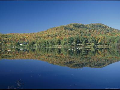 A Lake Surrounded by Trees Displaying the Colors of Autumn-Richard Nowitz-Photographic Print