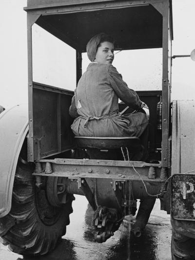 A Land Girl Driving a Tractor on a Farm During World War Ii-Robert Hunt-Photographic Print