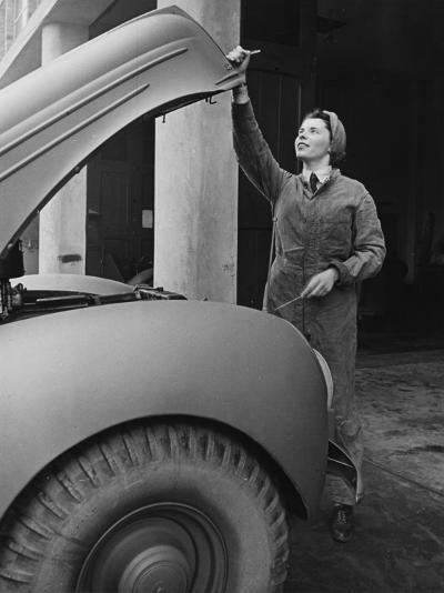 A Land Girl Mechanic Working on a Car During World War Ii-Robert Hunt-Photographic Print