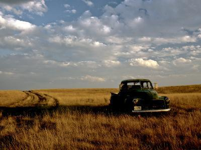 A Landscape of an Old Farm Truck in a Field at Sunset-Kenneth Ginn-Photographic Print
