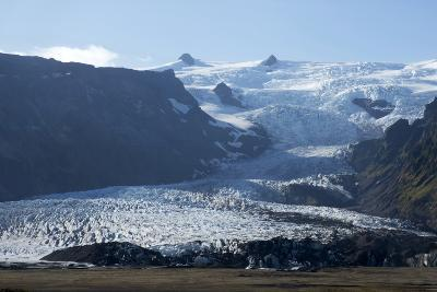 A Landscape View of a Glacier. With Snow Covered Mountains in the Background-Natalie Tepper-Photo