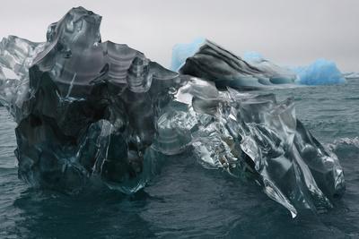 A Large Block of Sculptured Ice Floating on Jokulsarlon Lagoon-Raul Touzon-Photographic Print