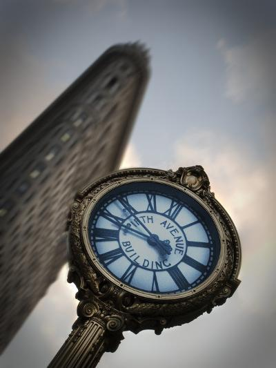 A Large Clock in Front If the Flatiron Building on 5th and Broadway-Keith Barraclough-Photographic Print