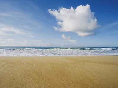 A Large Cloud Dominates the Sky as the Surf Rolls onto a Sandy Beach-Skip Brown-Photographic Print
