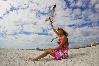 A Laughing Gull Swoops Down for a Cookie in a Woman's Hand at the Beach-Mike Theiss-Photographic Print