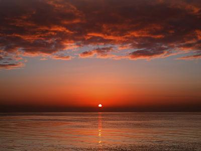 A Layer of Clouds Is Lit by the Rising Sun over Rio De La Plata, Buenos Aires, Argentina-Stocktrek Images-Photographic Print