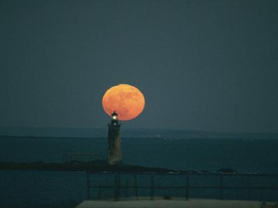 A Lighthouses Silhouette against a Full Moon-Bill Curtsinger-Photographic Print