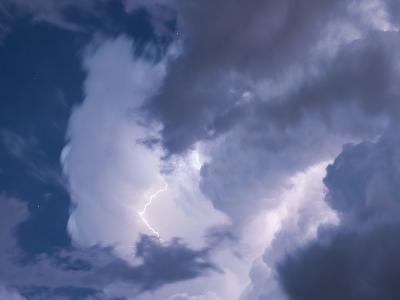 A Lightning Strike Severs the Cloud Filled Sky-Peter Carsten-Photographic Print