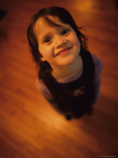A Little Girl Looks up and Smiles-Stephen Alvarez-Photographic Print