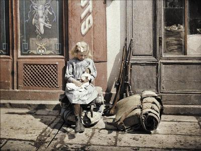 A Little Girl Playing with Her Doll; Two Guns and a Knapsack are Next to Her on the Ground, Reims,…-Fernand Cuville-Giclee Print