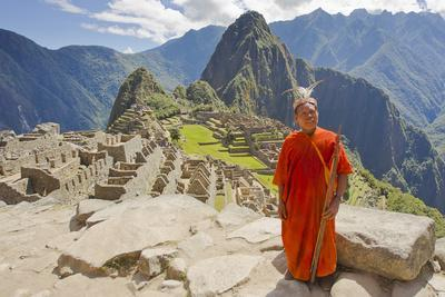 A Local Tribesman with a Spear Chants on a Cliff at Machu Picchu-Mike Theiss-Photographic Print