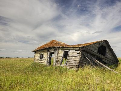 A Log Cabin Collapses into the Prairie Landscape-Pete Ryan-Photographic Print