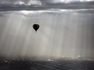 A Lone Balloon Drifts Near the Foothills of Albuquerque, N.M.