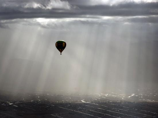 A Lone Balloon Drifts Near the Foothills of Albuquerque, N.M.--Photographic Print