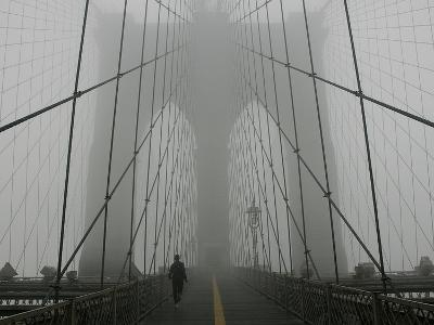 A Lone Runner Makes His Way Across the Fog-Shrouded Brooklyn Bridge Christmas Morning--Photographic Print