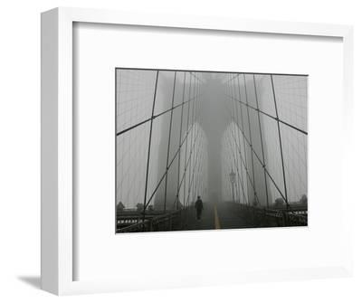 A Lone Runner Makes His Way Across the Fog-Shrouded Brooklyn Bridge Christmas Morning