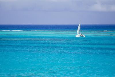 A Lone Sailboat in Turquoise Caribbean Waters Just Offshore-Mike Theiss-Photographic Print