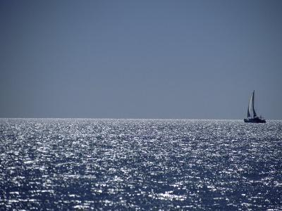 A Lone Sailboat on the Horizon in Shark Bay-Jason Edwards-Photographic Print