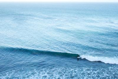 A Lone Surfer Rides a Pacific Wave-Ben Horton-Photographic Print