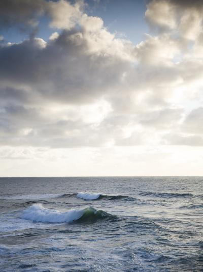 A Lone Wave Breaks as the Clouds Glow at Sunset-Michael Hanson-Photographic Print