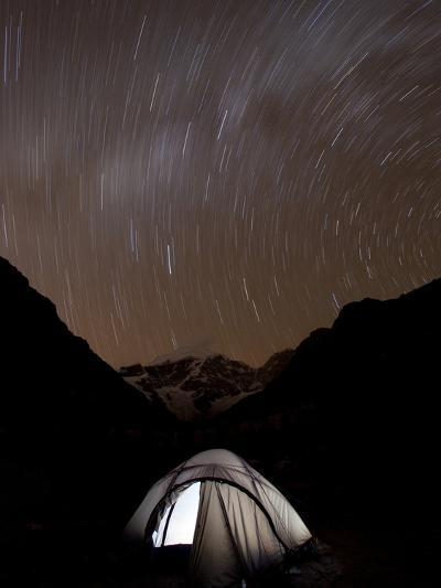 A Long Exposure Reveals the Earth Rotation Above Tents at Jhangothang-Alex Treadway-Photographic Print