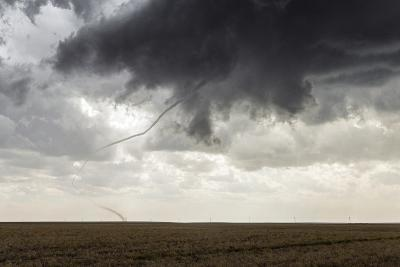 A Long, Snake-Like, Tornado Spins across Cropland-Jim Reed-Photographic Print