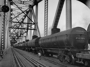 A Long String of Tank Cras Heading across the Huey Long Bridge