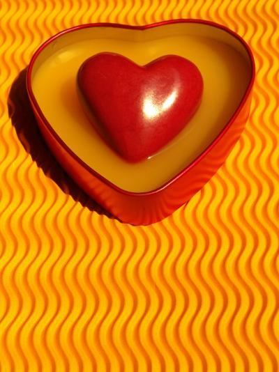 A Love Stone Heart with Yellow Background-Abdul Kadir Audah-Photographic Print
