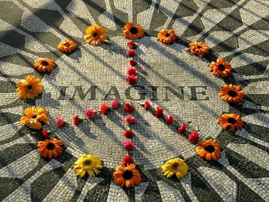A Makeshift Peace Sign of Flowers Lies on Top John Lennon's Strawberry Fields Memorial--Photographic Print