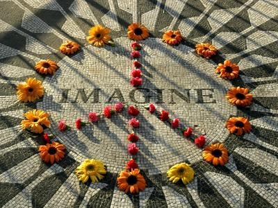 https://imgc.artprintimages.com/img/print/a-makeshift-peace-sign-of-flowers-lies-on-top-john-lennon-s-strawberry-fields-memorial_u-l-q10om390.jpg?p=0